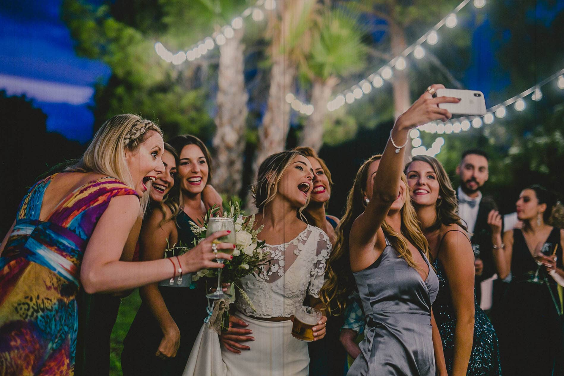 bride and her friends taking a selfie