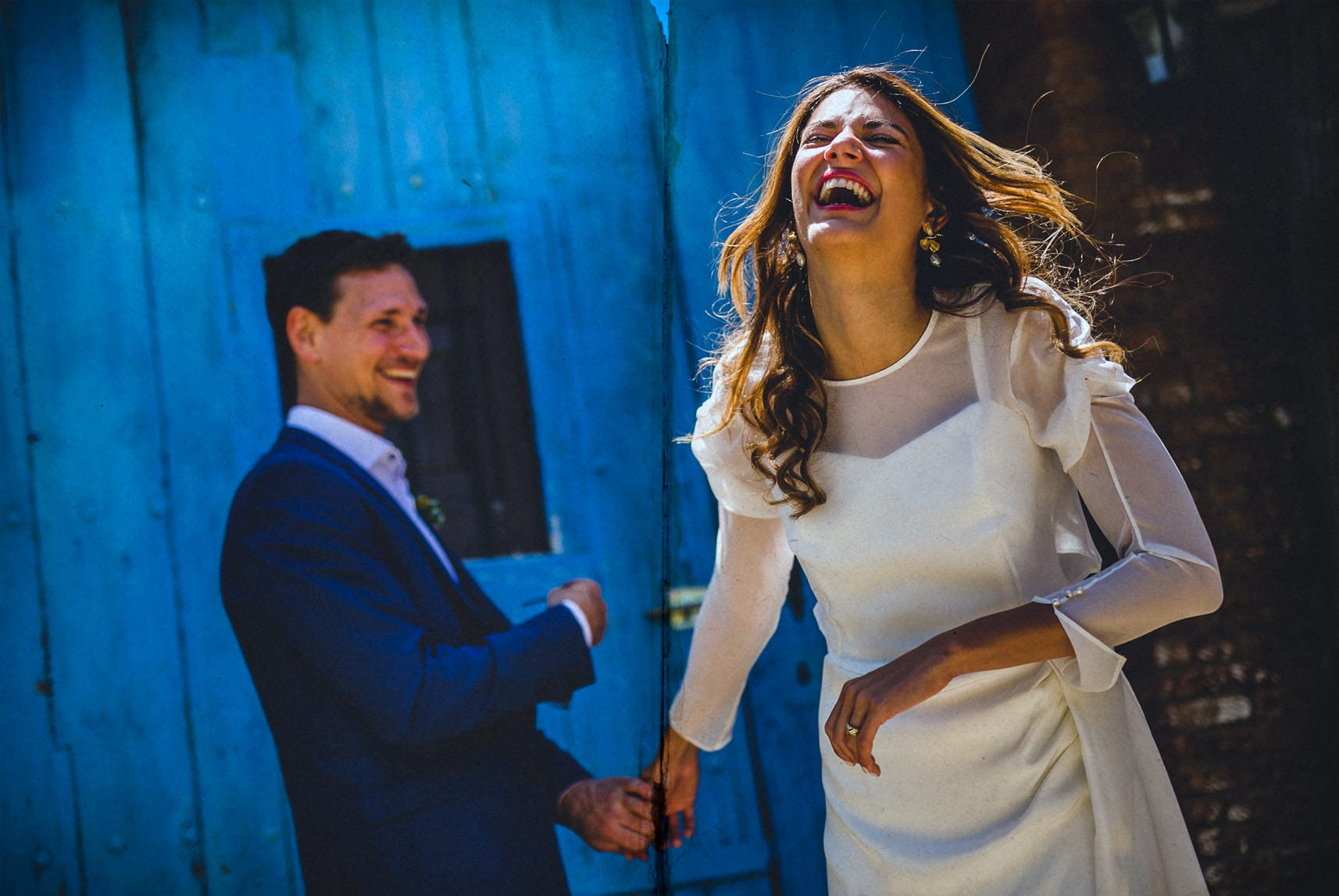 Beautiful bride  and handsome groom laughing in their Alicante wedding