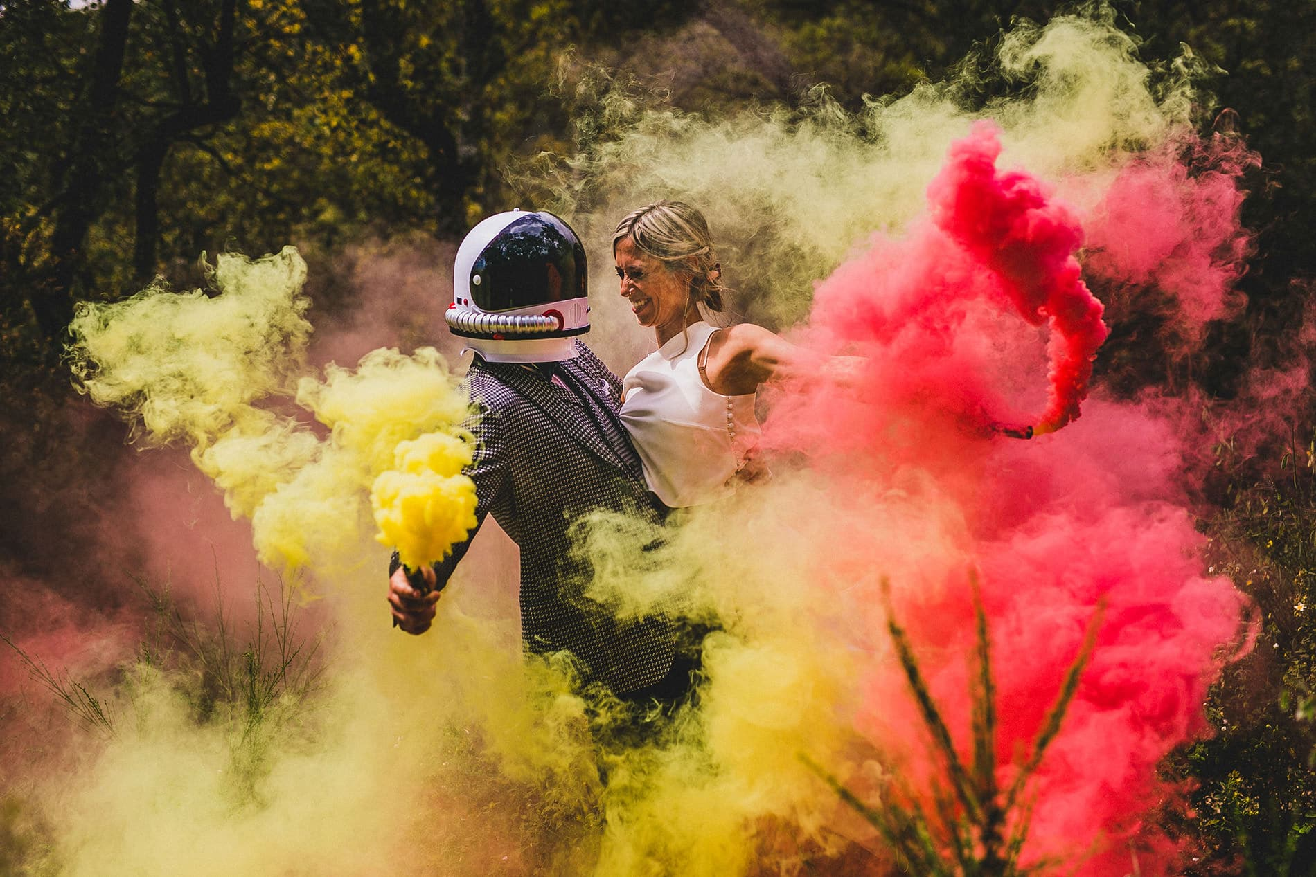 Bride and astronaut groom and color smoke bombs