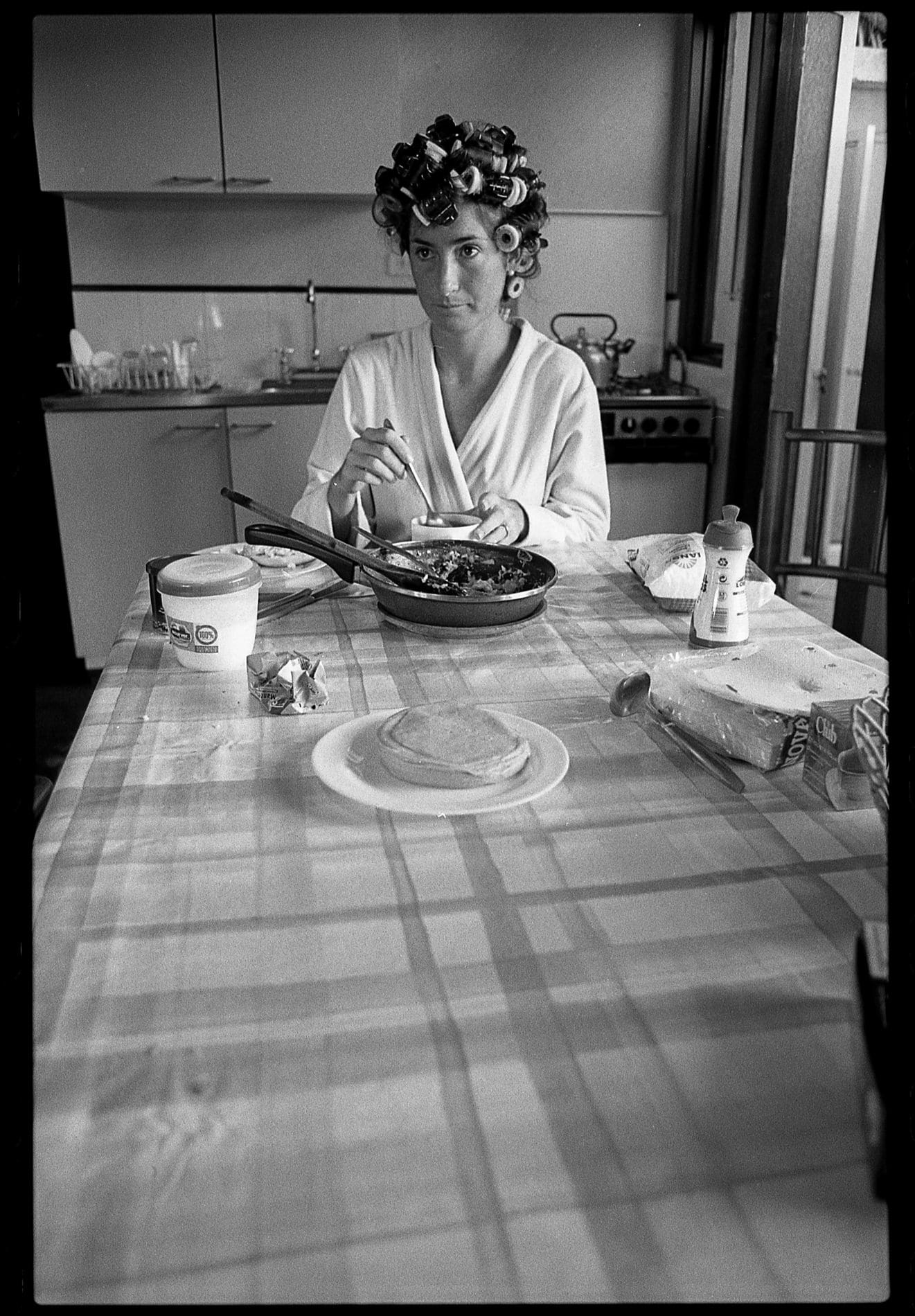 bride eating breakfast in black and white film